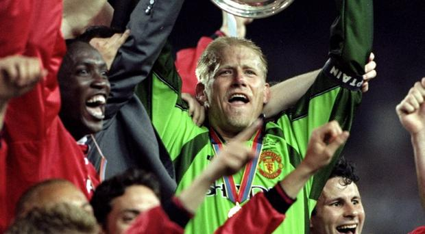 26 May 1999: Peter Schmeichel lifts the trophy after a 2-1 victory over Bayern Munich in his last game for Manchester United in the UEFA Champions League Final at the Nou Camp in Barcelona, Spain. United scored twice in injury time to win 2-1