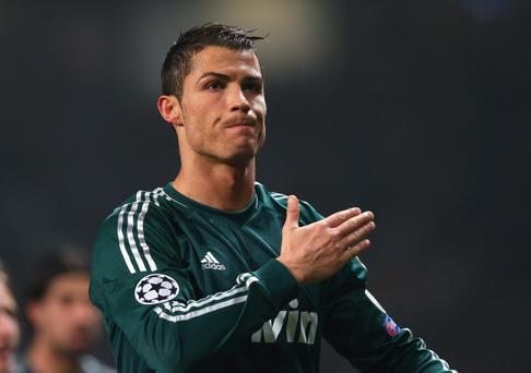 MANCHESTER, ENGLAND - MARCH 05: Cristiano Ronaldo of Real Madrid salutes the crowd at the end of the UEFA Champions League Round of 16 Second leg match between Manchester United and Real Madrid at Old Trafford on March 5, 2013 in Manchester, United Kingdom. (Photo by Alex Livesey/Getty Images)