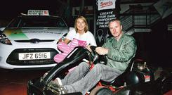 Clic Sergeant representative Gemma McCallam gets some tips from racing driver Eddie Irvine for the charity karting event organised by Acclaim Driving School