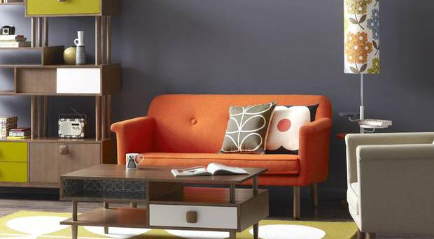 Keen as mustard: Combine orange, mustard and bold patterns with charcoal grey for a contemporary take on 1970s style. Orla Kiely House sofa, £2,195, heals.co.uk
