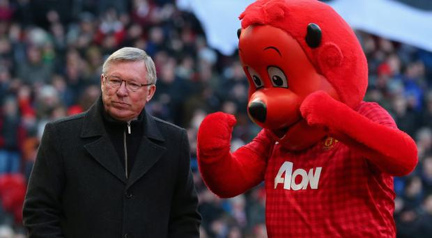 MANCHESTER, ENGLAND - MARCH 10: Manchester United Manager Sir Alex Ferguson walks with Mascot Fred the Red prior to the FA Cup sponsored by Budweiser Sixth Round match between Manchester United and Chelsea at Old Trafford on March 10, 2013 in Manchester, England. (Photo by Alex Livesey/Getty Images)