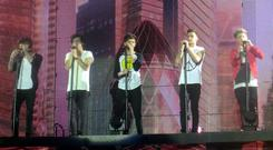 One Direction performing on stage at the Odyssey Arena. Friday 8th March 2013. Photo submitted by Muriel Sayers