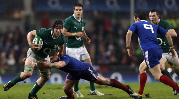 DUBLIN, IRELAND - MARCH 09: Sean O'Brien of Ireland is tackled by Benjamin Kayser of France during the RBS Six Nations match between Ireland and France at the Aviva Stadium on March 9, 2013 in Dublin, Ireland. (Photo by Bryn Lennon/Getty Images)