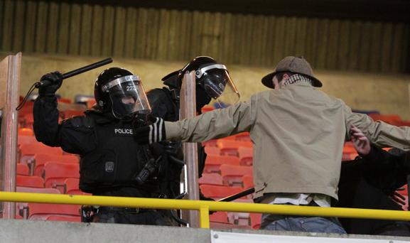 PSNI offices try to restore calm after Shamrock Rovers fans broke through a cordon to taunt Linfield fans