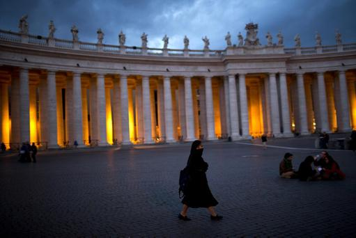 A nun walks inside St. Peter's Square, at the Vatican, Monday, March 11, 2013.