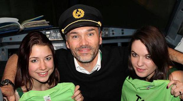 TCD students Rosie Goulding and Nicole O'Sullivan (right) with a pilot during the TCD Jailbreak adventure