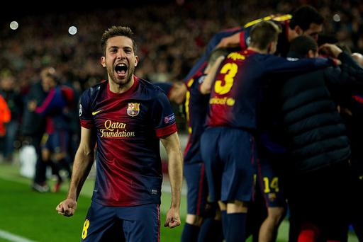 BARCELONA, SPAIN - MARCH 12: Jordi Alba of FC Barcelona celebrates scoring their fourth goal during the UEFA Champions League Round of 16 second leg match between FC Barcelona and AC Milan at Camp Nou Stadium on March 12, 2013 in Barcelona, Spain. (Photo by Gonzalo Arroyo Moreno/Getty Images)