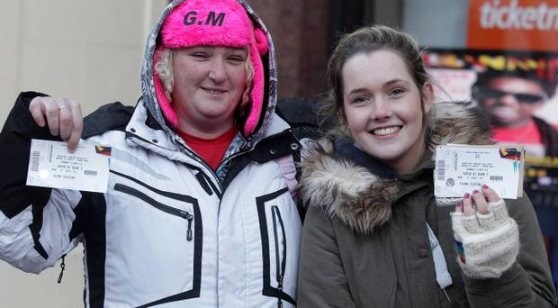 Northern Ireland- 7th December 2012 Mandatory Credit - Photo-Jonathan Porter/Presseye. JLS, Girls Aloud and Mrs Brown tickets go on sale at Ticketmaster in Belfast City Centre. People pictured queuing up for the tickets. Left to right. Patricia Roach and Amy McCord.