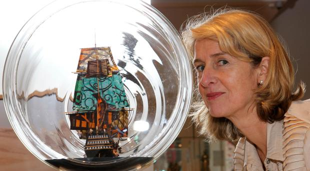 Penny Johnston, Director of the Government Art Collection with Yinka Shonibare's 'Nelson's Ship in a Bottle', part of Revealed, an exhibition of more than 160 works from the UK Government Art Collection, usually displayed in official residences and government buildings around the world.