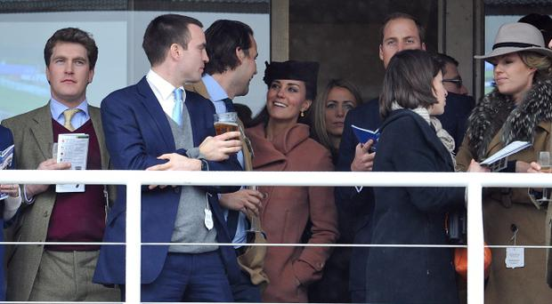 The Duke and Duchess of Cambridge during the Cheltenham Gold Cup Day on Day Four of the 2013 Cheltenham Festival at Cheltenham Racecourse, Gloucestershire.
