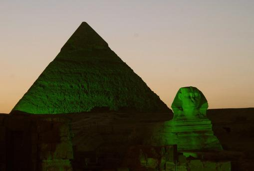Pyramids and Sphinx in Giza, Egypt, which have been lit green for St. Patrick's Day.