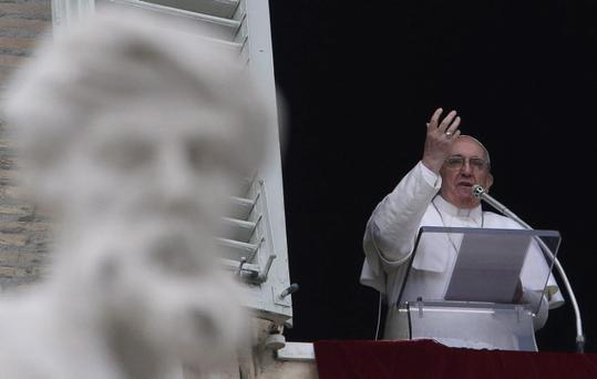 Pope Francis delivers his Angelus prayer from the window of his studio overlooking St. Peter's Square, at the Vatican, Sunday, March 17, 2013. (AP Photo/Gregorio Borgia)