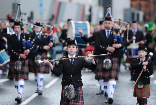 17/3/13 PACEMAKER PRESS INTL. The St. Patrick's Day parade from Belfast City Hall as watched by thousands as it made it's way to Custom House Square for a festival concert. Picture Charles McQuillan/Pacemaker.