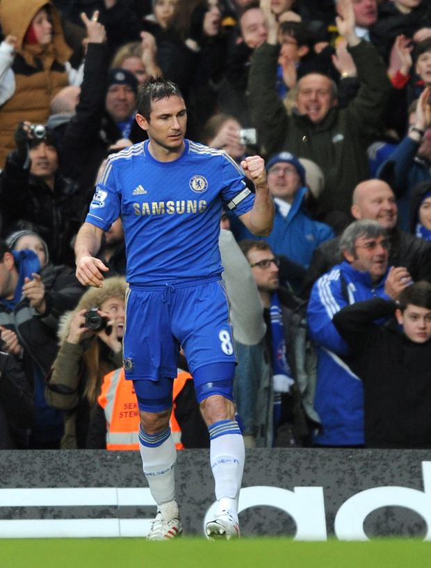 LONDON, ENGLAND - MARCH 17: Frank Lampard of Chelsea celebrates scoring the opening goal during the Barclays Premier League match between Chelsea and West Ham United at Stamford Bridge on March 17, 2013 in London, England. (Photo by Steve Bardens/Getty Images)