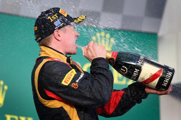 MELBOURNE, AUSTRALIA - MARCH 17: Kimi Raikkonen of Finland and Lotus celebrates on the podium after winning the Australian Formula One Grand Prix at the Albert Park Circuit on March 17, 2013 in Melbourne, Australia. (Photo by Clive Mason/Getty Images)