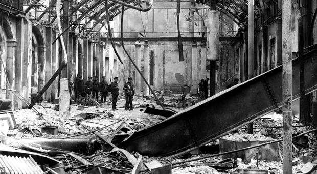 GPO in ruins 1916: Soldiers survey the interior of the post office in Sackville Street, Dublin, during the Easter Rising of 1916. (Photo by Hulton Archive/Getty Images)
