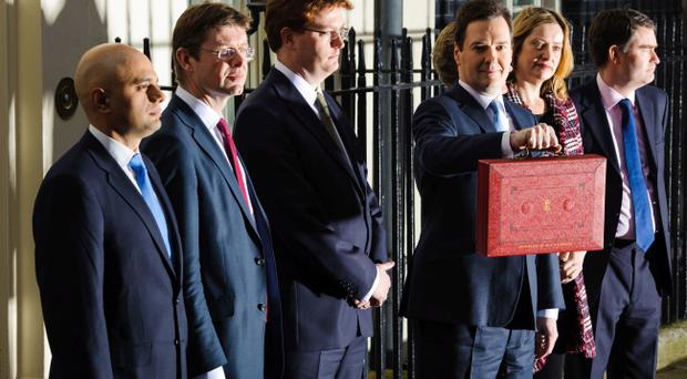 George Osborne holds his red box aloft
