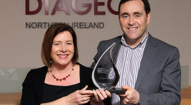 Lynn Graham, HR Business Partner Diageo NI and Michael McCann, Country Director Diageo NI with the 'Best Large Place to Work' Award