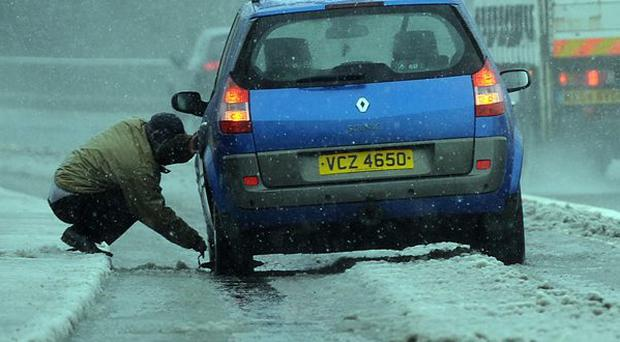 PACEMAKER BELFAST 22/3/2013 An unfortunate motorist on the M1 , with the weather causing problems across the country Photo Colm Lenaghan/Pacemaker Press