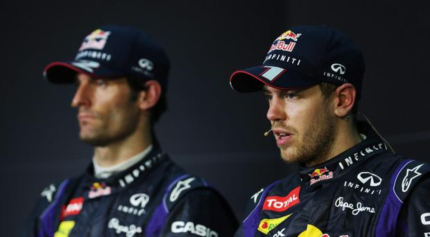 KUALA LUMPUR, MALAYSIA - MARCH 24: Race winner Sebastian Vettel (R) of Germany and Infiniti Red Bull Racing and second placed Mark Webber (L) of Australia and Infiniti Red Bull Racing react in the drivers press conference following the Malaysian Formula One Grand Prix at the Sepang Circuit on March 24, 2013 in Kuala Lumpur, Malaysia. (Photo by Mark Thompson/Getty Images)