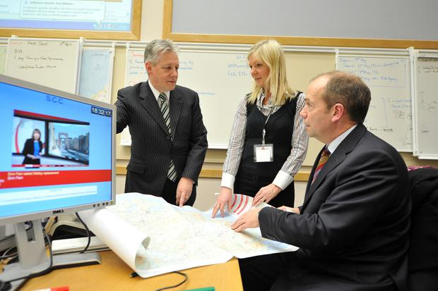First Minister Peter D. Robinson, joins Suzanne Wylie, Local Government Emergency Response Team and Michael McBride, Chief Medical Officer during a visit the Multi Agency Strategic Coordination Centre to view the emergency response to the severe weather