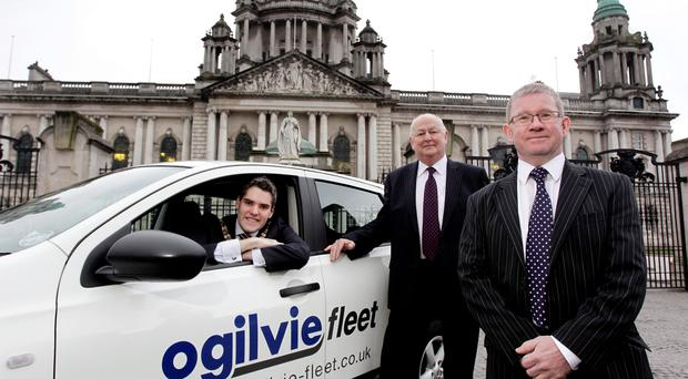 Ogilvie regional manager Jim Humphreys (centre) with the Belfast Lord Mayor, Gavin Robinson (left) and Ogilvie managing director Gordon Steven
