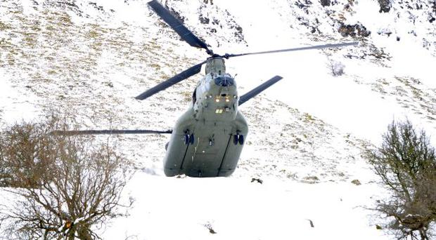 Pictures of the Chinook over James McHenry's farm just outside Glenariff, Co Antrim. The Chinook was dropping fodder to McHenry's sheep on the other side of the mountain.
