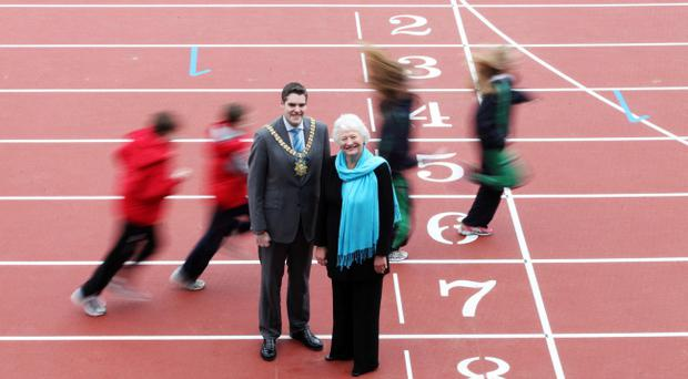 Dame Mary Peters and Belfast Lord Mayor Gavin Robinson admire the new 400-seater stand