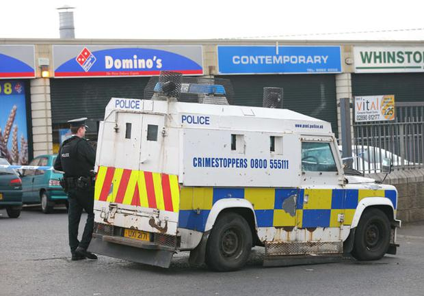 PSNI Officers at the scene of a shooting outside Domino's pizza shop