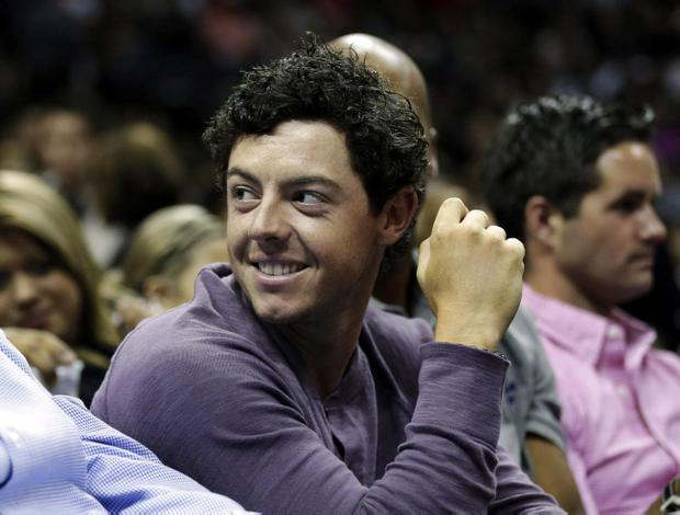 Golfer Rory McIlroy attends an NBA basketball game between the San Antonio Spurs and Miami Heat, Sunday, March 31, 2013, in San Antonio