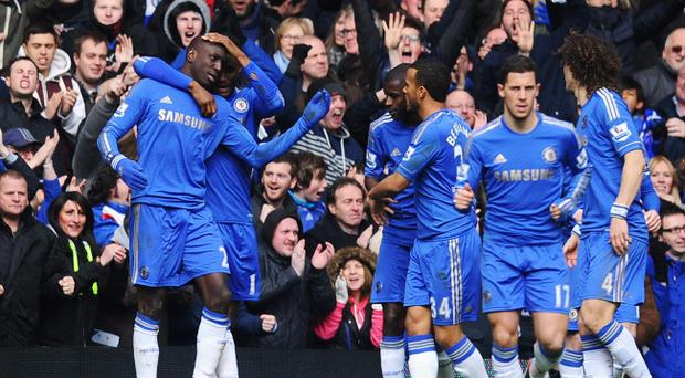 LONDON, ENGLAND - APRIL 01: Demba Ba (L) of Chelsea celebrates his goal with team mate Mikel during the FA Cup with Budweiser Sixth Round Replay match between Chelsea and Manchester United at Stamford Bridge on April 1, 2013 in London, England. (Photo by Mike Hewitt/Getty Images)