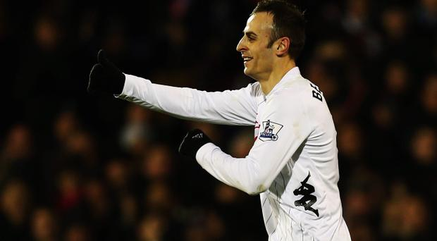 LONDON, ENGLAND - APRIL 01: Dimitar Berbatov of Fulham celebrates scoring his sides second goal during the Barclays Premier League match between Fulham and Queens Park Rangers at Craven Cottage on April 1, 2013 in London, England. (Photo by Clive Rose/Getty Images)