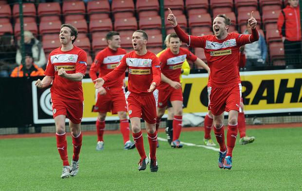 Cliftonville players celebrate at the end of their 3-1 win over Crusaders