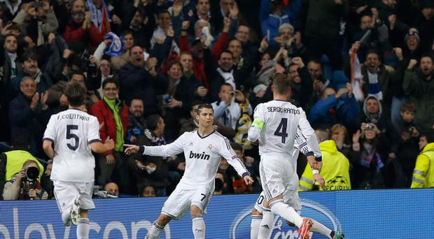 Real Madrid's Cristiano Ronaldo from Portugal, center, reacts after scoring the opening goal during the Champions League quarterfinals first leg soccer match between Real Madrid and Galatasaray at the Santiago Bernabeu stadium, in Madrid, Wednesday, April 3, 2013. (AP Photo/Daniel Ochoa de Olza)