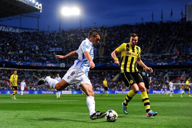 MALAGA, SPAIN - APRIL 03: Jeremy Toulalan of Malaga CF clears the ball under pressure from Kevin Grosskreutz of Borussia Dortmund during the UEFA Champions League quarter-final first leg match between Malaga CF and Borussia Dortmund at La Rosaleda Stadium on April 3, 2013 in Malaga, Spain. (Photo by David Ramos/Getty Images)