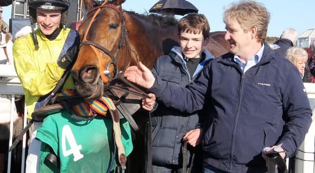 Pineau De Re with jockey Danny Mullins and trainer Philip Fenton after victory in the Toals Ulster Grand National at Downpatrick