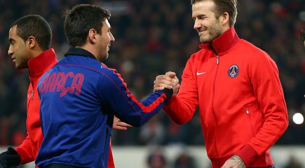 PARIS, FRANCE - APRIL 02: David Beckham (R) of PSG shakes hands with Lionel Messi of Barcelona ahead of the UEFA Champions League Quarter Final match between Paris Saint-Germain and Barcelona FCB at Parc des Princes on April 2, 2013 in Paris, France. (Photo by Clive Rose/Getty Images)