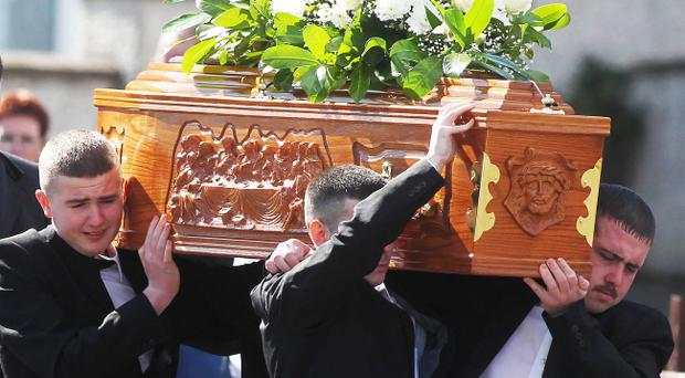 Funeral of Kieran McManus who was shot dead in west Belfast last Saturday night. The 26-year-old father of one was shot as he got into his car outside Domino's Pizza on Kennedy Way. Mr McManus' coffin is carried from the family home in Crumlin, Co. Antrim for Requiem Mass at Holy Trinity Church in west Belfast