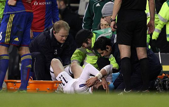 Tottenham Hotspur's Gareth Bale leaves the pitch on a stretcher after picking up an injury during the UEFA Europa League, Quarter Final, First Leg match at White Hart Lane, London. PRESS ASSOCIATION Photo. Picture date: Thursday April 4, 2013. See PA story SOCCER Tottenham. Photo credit should read: John Walton/PA Wire