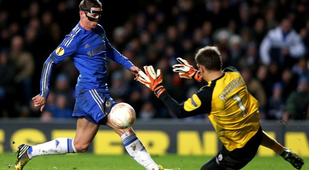 LONDON, ENGLAND - APRIL 04: Goalkeeper Sergei Ryzhikov of Rubin Kazan smotghers the ball as Fernando Torres of Chelsea closes in during the UEFA Europa League quarter final first leg match between Chelsea and FC Rubin Kazan at Stamford Bridge on April 4, 2013 in London, England. (Photo by Ian Walton/Getty Images)