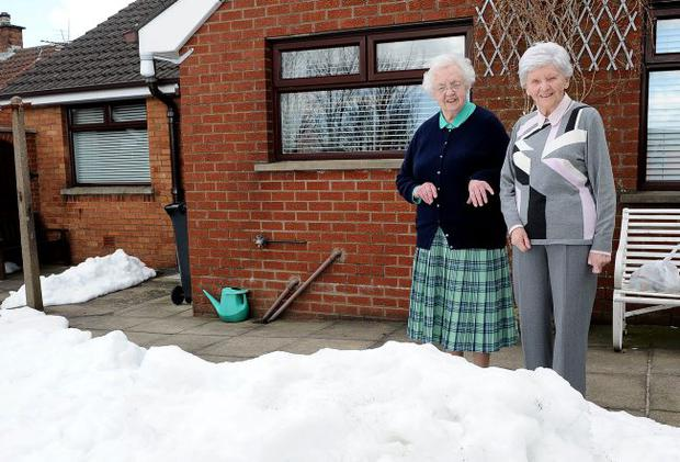 Gretta and May Henderson at their Carnhill Road home in Newtownabbey where they were snowed in for two weeks and had to rely on neighbours for food deliveries