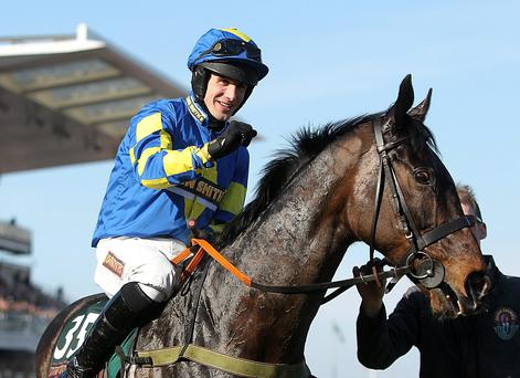 Ryan Mania celebrates on Auroras Encore after winning the John Smith's Grand National Chase