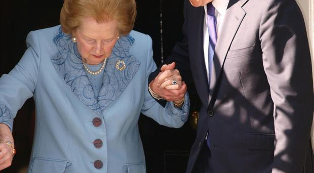 Baroness Thatcher in Downing Street...Prime Minister David Cameron helps Baroness Thatcher as she leaves Downing Street