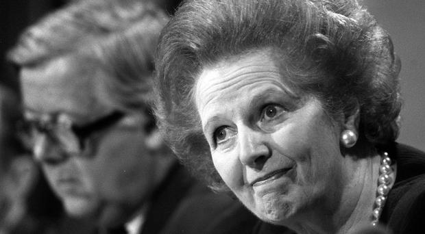 Margaret Thatcher fielding questions with Foreign Secretary, Geoffrey Howe (background), at a press conference, in London
