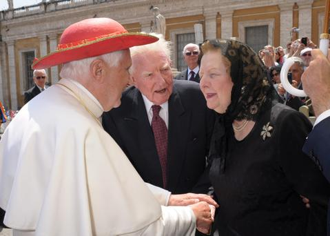 In this photo provided by the Vatican newspaper L'Osservatore Romano, Pope Benedict XVI, wearing his Saturn hat, greets former British Prime Minister Margaret Thatcher at the end of his weekly general audience in St. Peter's Square, at the Vatican, Wednesday, May 27, 2009