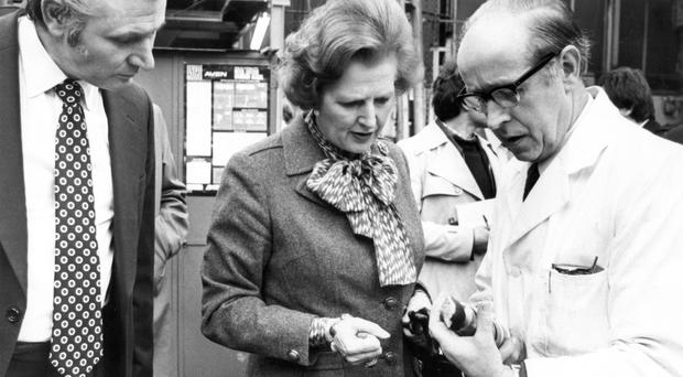 Former Prime Minister Margaret Thatcher. Visit to Northern Ireland. Director of the Belfast Tool and Gauge Company, Mr David Woods (left) discusses the workings of engineering components with Margaret Thatcher and department foreman Mr Robert McCullough at the factory. 6/3/1981 BELFAST TELEGRAPH ARCHIVE