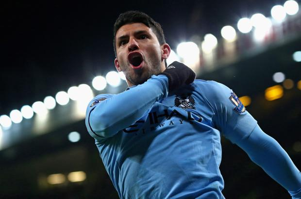 Sergio Aguero of Manchester City celebrates scoring his team's second goal to make the score 1-2 during the Barclays Premier League match between Manchester United and Manchester City at Old Trafford on April 8, 2013