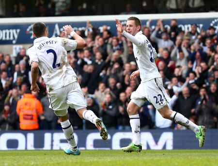 LONDON, ENGLAND - APRIL 07: Gylfi Sigurdsson of Tottenham Hotspur celebrates scoring their second goal with Clint Dempsey of Tottenham Hotspur during the Barclays Premier League match between Tottenham Hotspur and Everton at White Hart Lane on April 7, 2013 in London, England. (Photo by Clive Rose/Getty Images)
