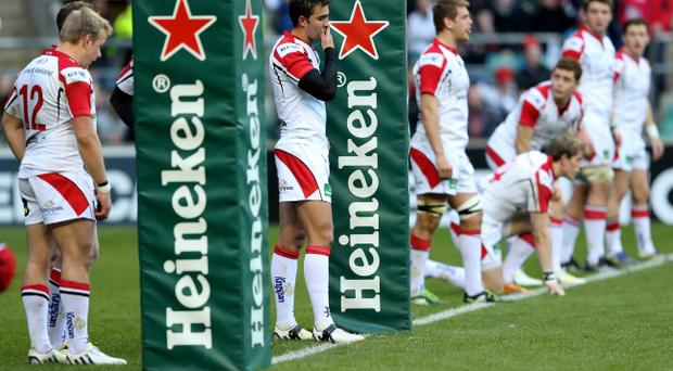 Dejected Ulster players look on during the Heineken Cup quarter final match between Saracens and Ulster at Twickenham Stadium on April 6, 2013