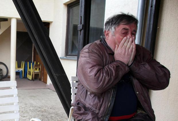 Radmilo Bogdanovic, brother of Ljubisa Bogdanovic cries in village of Velika Ivanca, Serbia, Tuesday, April 9, 2013. Ljubisa Bogdanovic a 60-year-old man gunned down 13 people, including a baby, in a house-to-house rampage in a quiet village